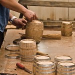 Craftsman putting the final touches on the assembly of barrels.     Photo by Sean Floars