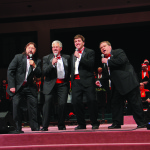 """Choraliers (from left) Jeff Koutnick, Steve Hein, Jake Tychan and Ryan Pick sing about the """"Christmas Can-Can."""""""