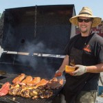 """Bacon's BBQ owner Ray Bacon with his meat smoker, """"Big Sexy,"""" which he constructed.  Photo courtesy Tamar Wilsher"""
