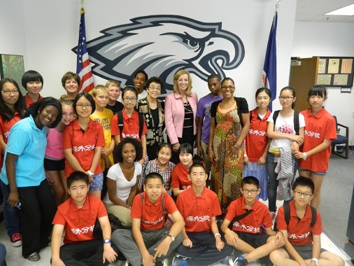 OHS and SFLS students with OHS Principal Cathy Benner, Kisha Wilson-Sogunro and Jean Chang, owner of Astar