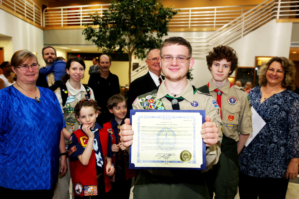 "Nicholas Guernsey, with friends and family after recently receiving commendation for an ""Act of Heroism"" from the Prince William Board of County Supervisors. Guernsey saved a man's life by administering CPR as the man was having a heart attack."