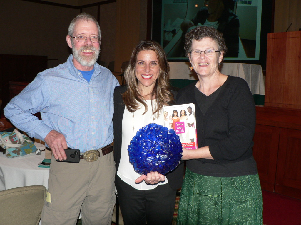 From right, honoree Kathleen McClelland with her husband Dan Nellis (left) and keynote speaker and film director Abby Epstein of The Business of Being Born.