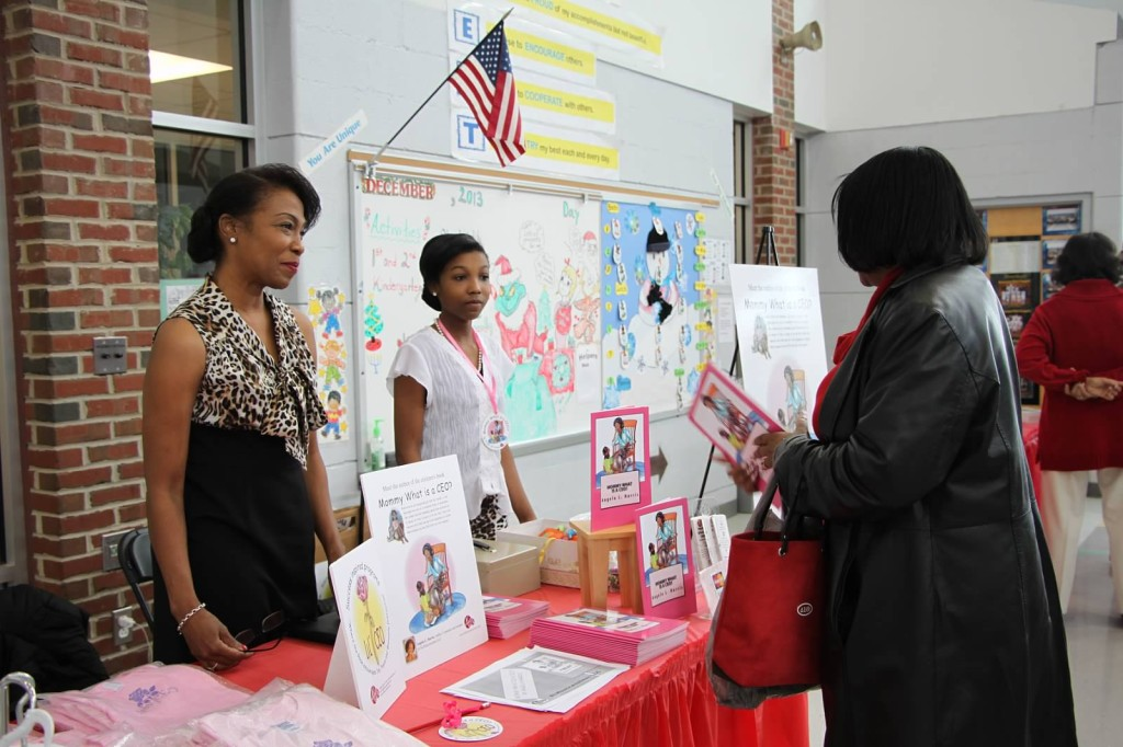 Children's book author Angela Harris discusses the inspiration for her books with a guest before the program started.
