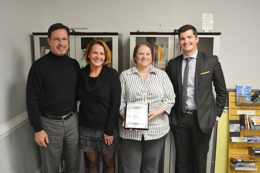 The Didlake team responsible for the organization's CIMS certification poses with the certification plaque. From left to right: Mike Payne, Vice President of Contract Operations; Rebecca Crampton, QA Manager; Brandy Emmons-Powell, Director of Quality Development; Jimmy Vickers III, Director of Metro 1 Contract Operations.