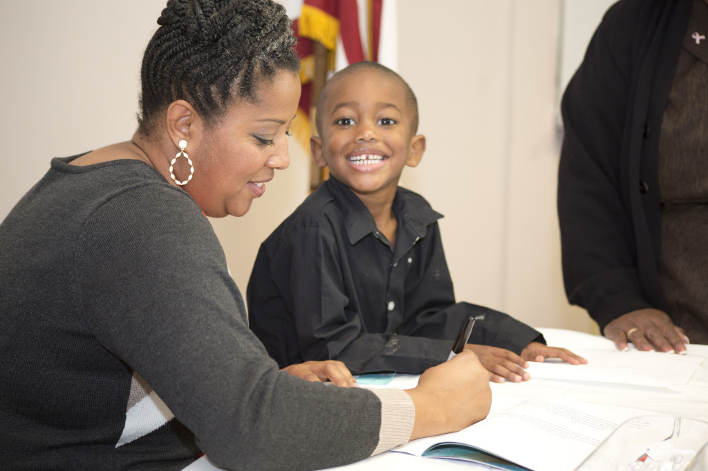 """Local children's author Tasha Fuller with her son Freddie Fuller III during a book signing for """"It's Bath Time Baby"""" at Chinn Park Regional Library in Lake Ridge. Her three children helped Fuller to select illustrations for the book and also promoted the book signing to classmates."""