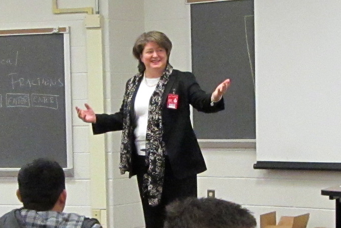 Attorney Tracey Lenox, a member of the Prince William County Bar Asociation and an Associate with Nichols Zauzig & Sandler law firm speaks with Stonewall High School students