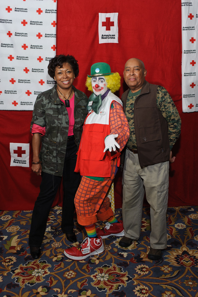 """Deborah Tompkins Johnson of Dominion Virginia Power, Donna Flory as """"Clara B. Ready"""" and Johnson's husband Reuben Johnson on March 19, 2011, at """"Heroes and Villains,"""" a fundraising gala for the local Red Cross."""