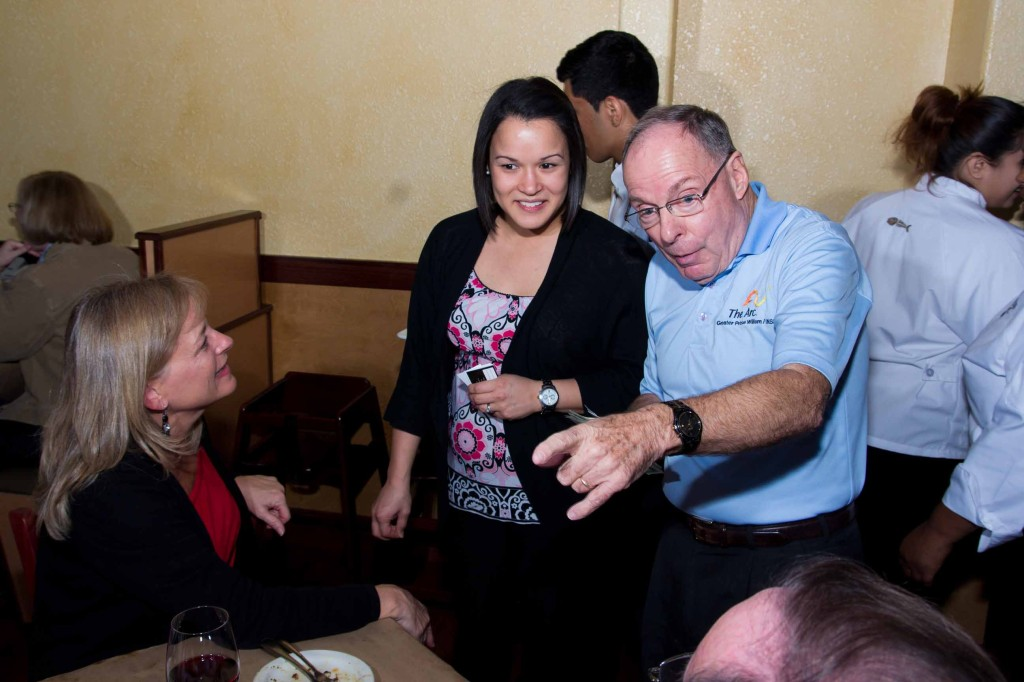 Anna Bennett, managing partner of the new Bonefish and The ARC Director of Resource Development Chris Caseman sell raffle tickets at a fundraiser the eatery hosted for the nonprofit organization.