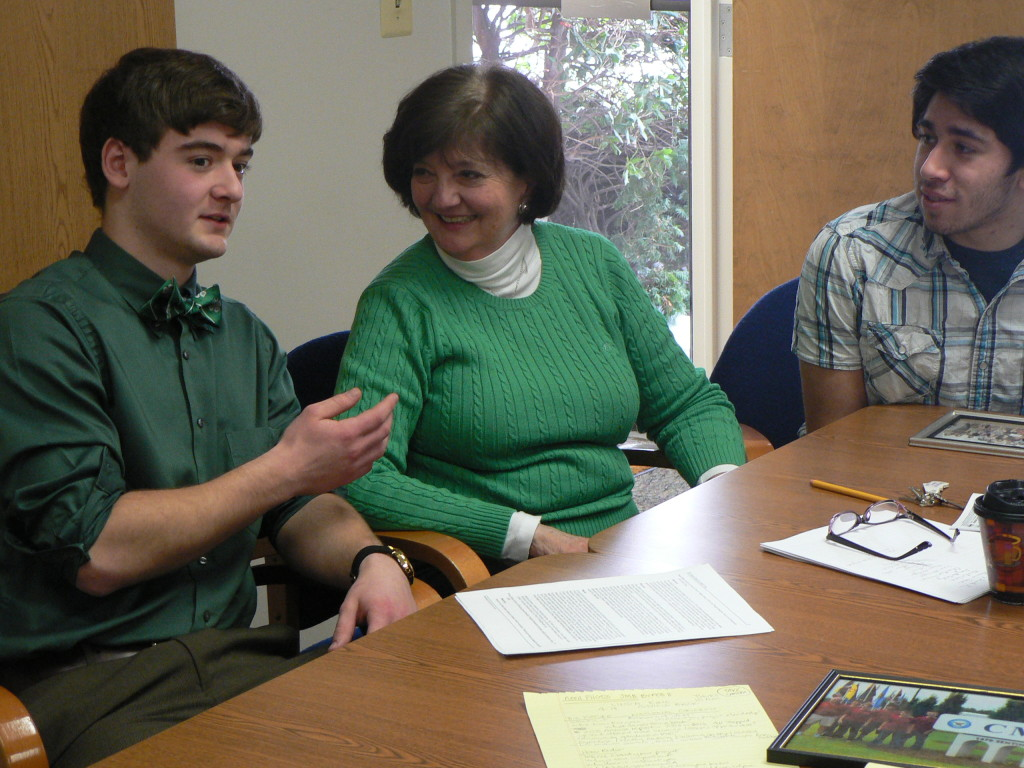 "4-H'ers Kipp Dunn (left) and Ryan Thies (right) meet with Linda King, Virginia Cooperative Extension agent for Prince William 4-H clubs. Dunn and Thies have both been inducted into the ""4-H All Stars."""