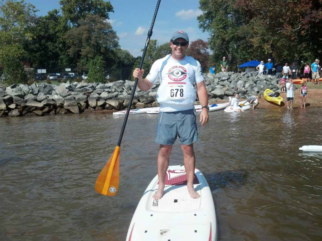 """own of Occoquan Mayor Earnie Porta was among participants in Quantico's first """"Blockade Run"""" Kayak Race, held last year."""