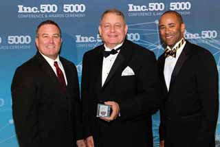 "FederalConference.com founders (from left) Stephen Davis and Paul Trapp with company partner and Chief Financial Officer Corey Holeman at the recent ""Inc. 500/5000"" awards ceremony."