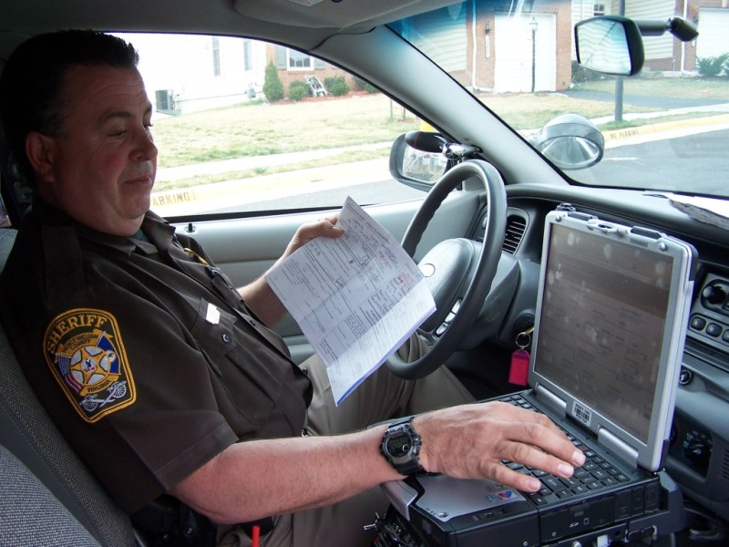 Sergeant Mark Hurd prepares to serve process papers, one of the primary duties of the Prince William County Sheriff's Office.