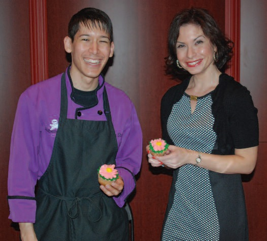The Aubergine Chef, aka Jason Shriner, and renowned cookbook author Amy Riolo bond over floral cupcake decorating.