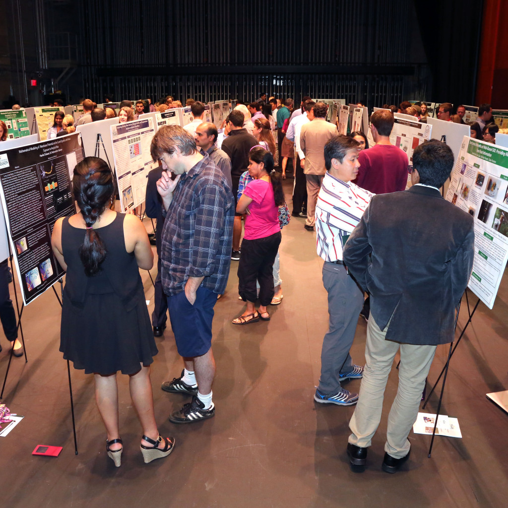 Young scientists exhibit their research at George Mason University's Aspiring Scientists Summer Internship Program.