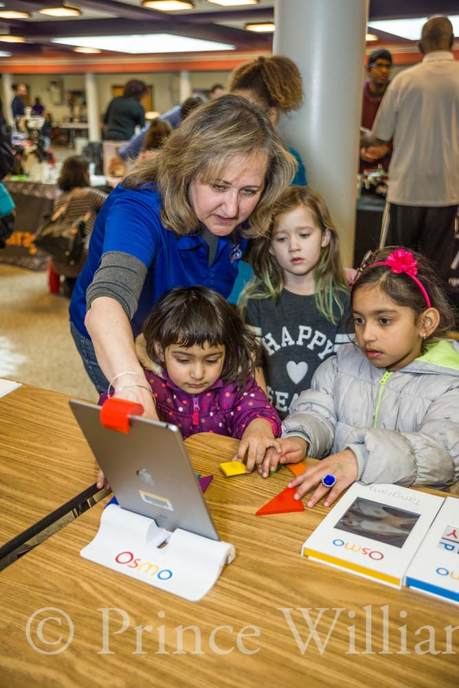 Children get involved with STEM activities through innovative technology and iPads.