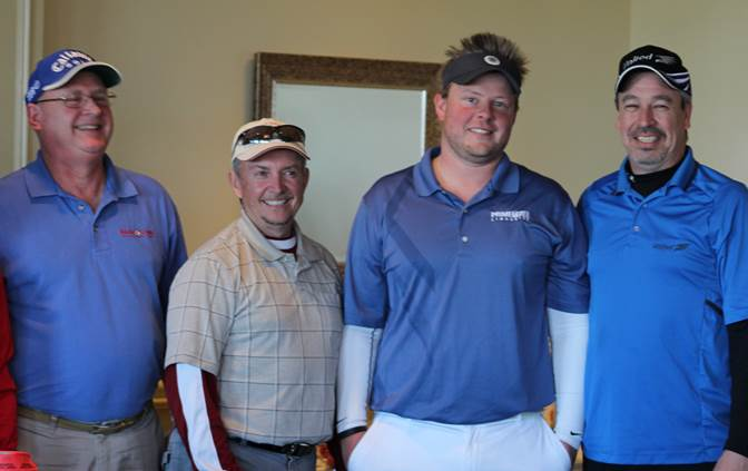 (From left) Ron Beckner, The Kloke Group/United Van Lines; Bob Goeddel, Bobby G's Disc Jockeys; Jamie Gravett, S.W. Rodgers Company, Inc. and Larry Peterman, The Kloke Group/United Van Lines—winning team on the back 9 of the course.