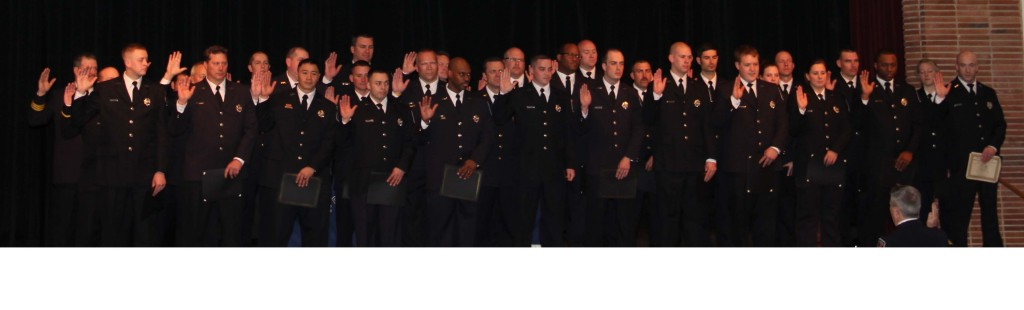 Chief McGee swearing in newly promoted members