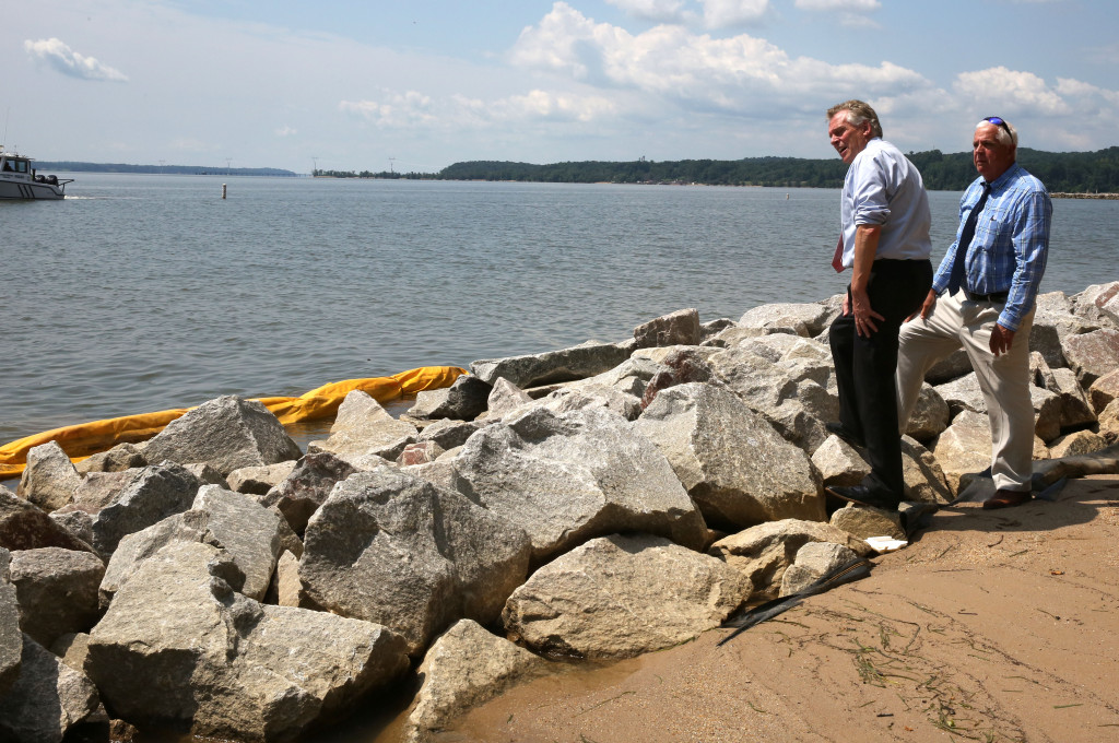 Virginia Gov. Terry McAuliffe and Scott Hardaway, of the Virginia Institute of Marine Sciences, look at the construction of the Living Shoreline project at Leesylvania State Park.