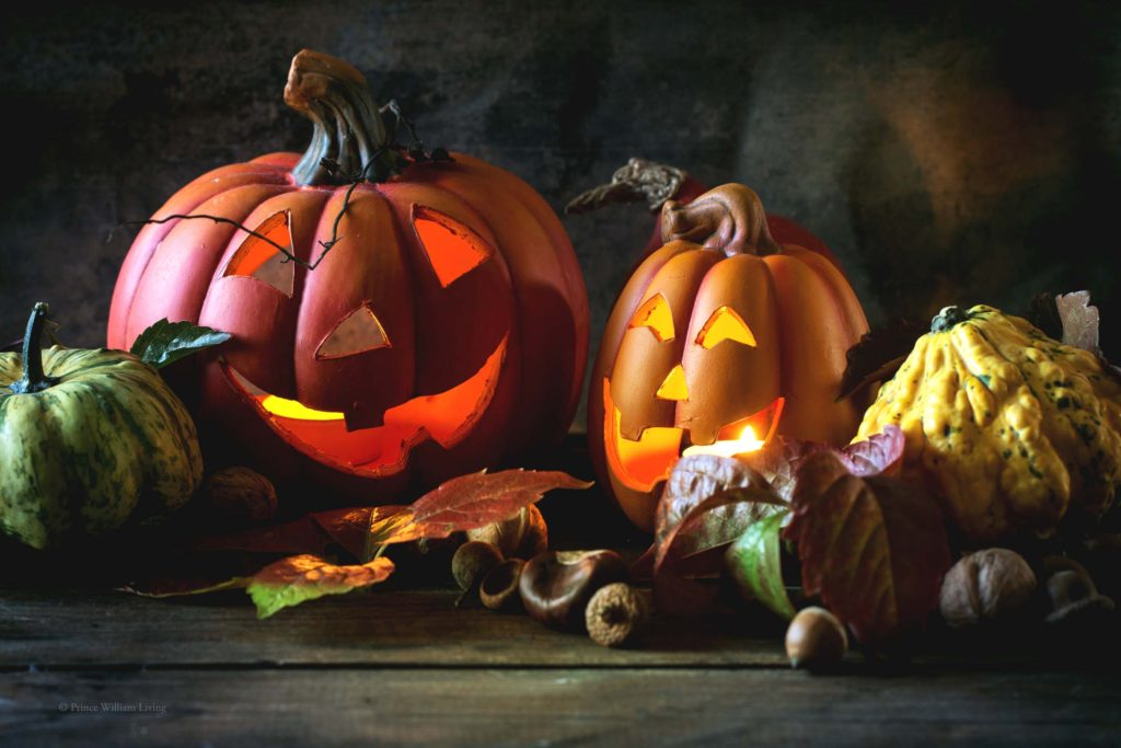 Halloween's pumpkins with autumn leaves on wooden table. See series.