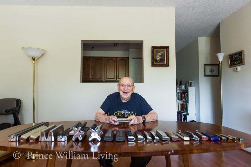 Jack Hopkins of Lake Ridge displays some of his large collection of harmonicas.