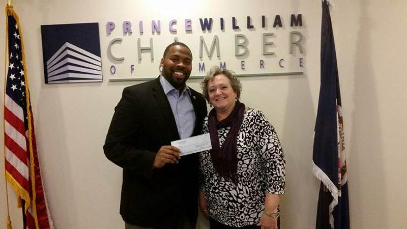 Dumfries resident Michael Futrell won $500 at Marketplace: The Local Experience. He is pictured with Prince William Chamber of Commerce President & CEO Debbie Jones.
