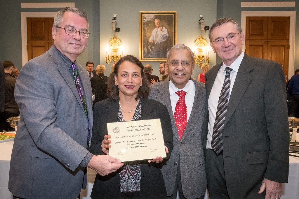 Pictured left to right: Dave Barber, ASWA Competition Chairman, Sudha Patil, Pandit Patil, Grant Crandall, Atlantic Seaboard Wine Association President.