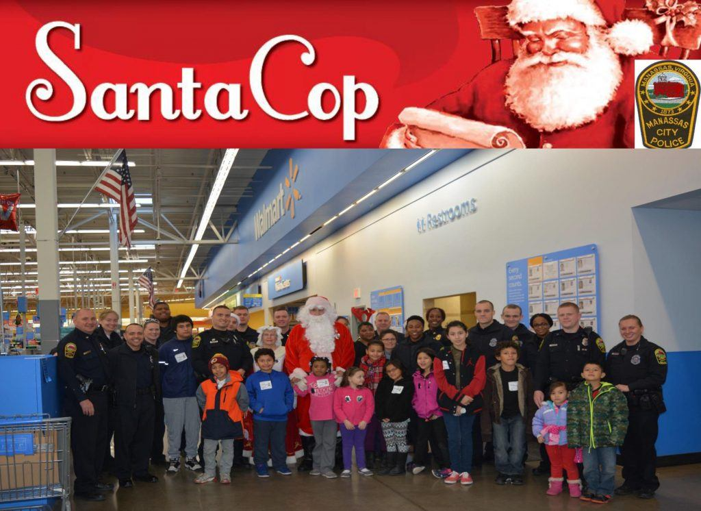 Manassas City Police members stand with children served during the Santa Cop program.